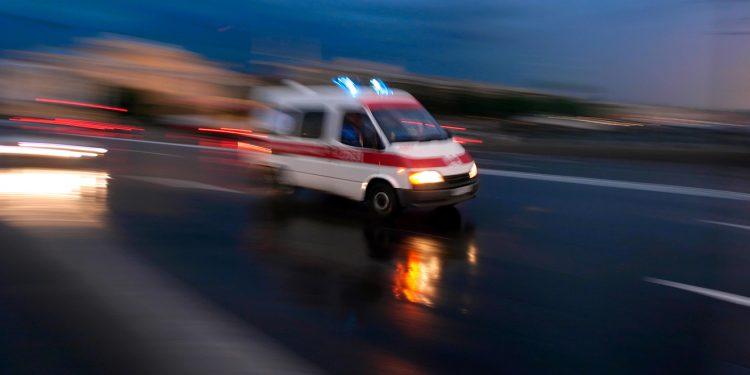 Ambulance car speeding, blurred motion
